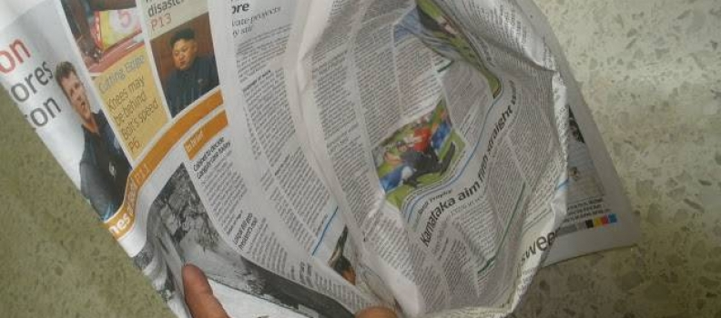 Replace Plastic Garbage Bags with Newspaper Liners